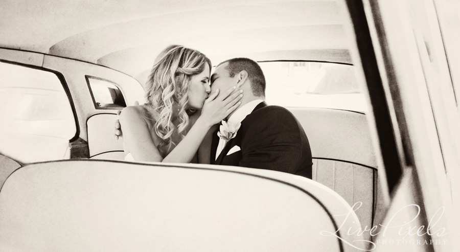 """bride and groom kissing in a vintage car"""