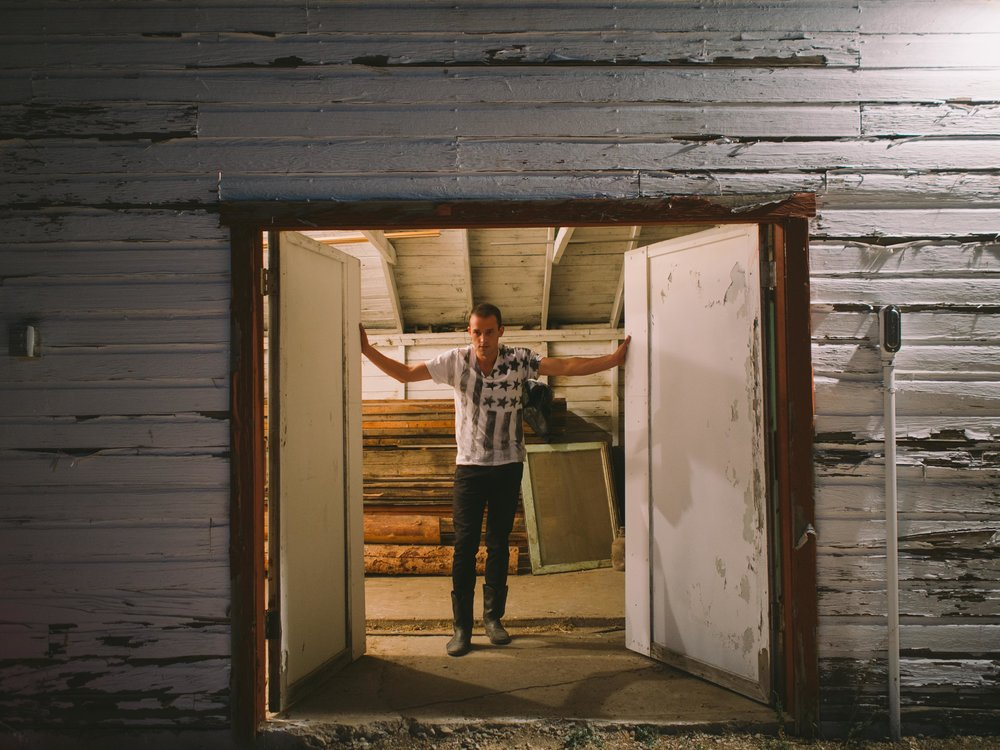 Erik (Evan Hall) Opening Shed Doors.jpg