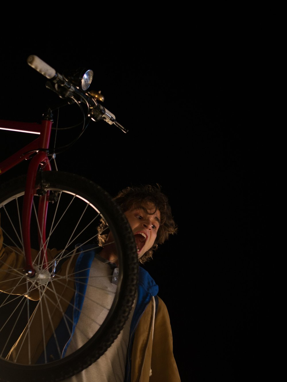 Jon (Jake Borelli) About To Throw Bike Off The Bridge 1.jpg