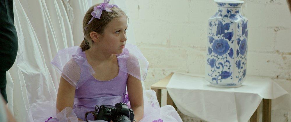 ZOE SCOWLS IN FLOWER GIRL DRESS.jpg
