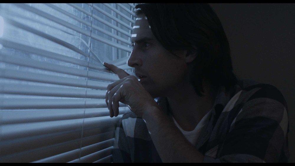 Jason-Looks-Out-Window2.jpg