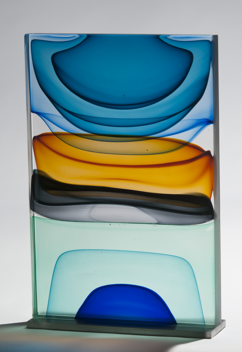 "Infusion Block in Blues, Ambers, Grey and Emerald,  Blown and Solid-Worked, Kiln-Cast, Cold-Worked Glass 12""W x 19""H x 4""D"