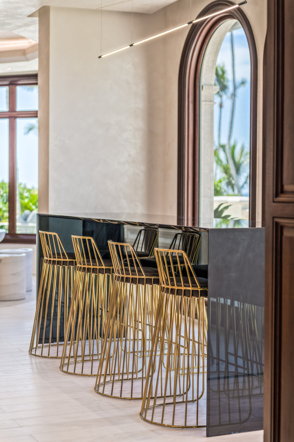 Private Beachfront Estate Bespoke kitchen Custom architectural and decorative details throughout, including black glass table by designer Chad Jensen