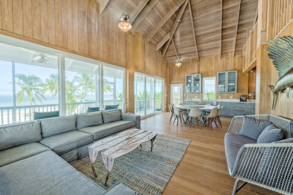 Private Island Beach House Architectural restructuring toward open concept living space including artist commissioned sculpted tables