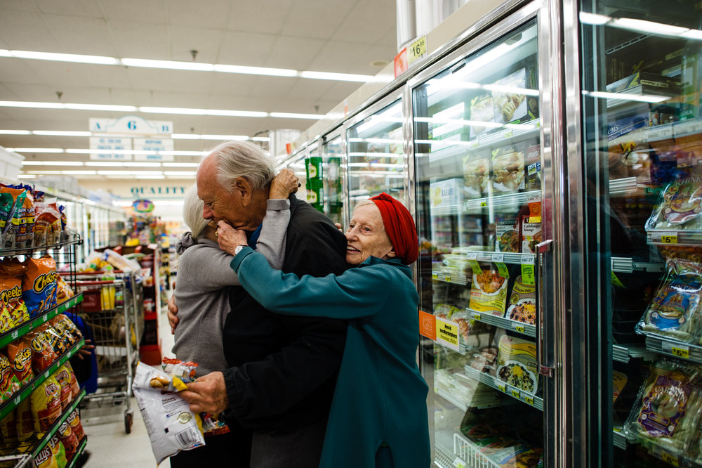 Jeanie and Adina embrace Will in the supermarket aisle.