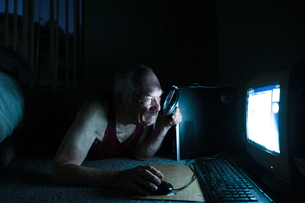 Passionate about solitaire, Will searches for the game on his computer at night.