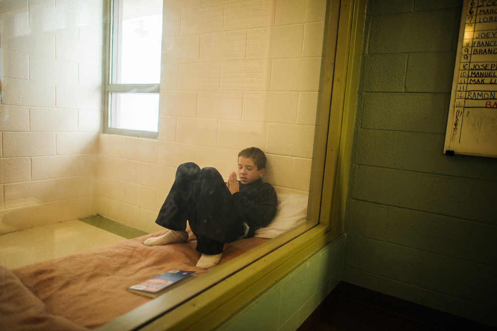 Vinny, age 13, prays inside his cell at the juvenile detention center, 2012.