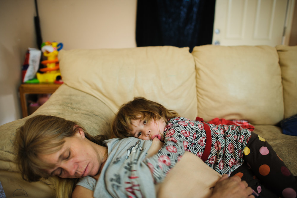 Elycia is breastfed, as Eve sleeps, 2012.