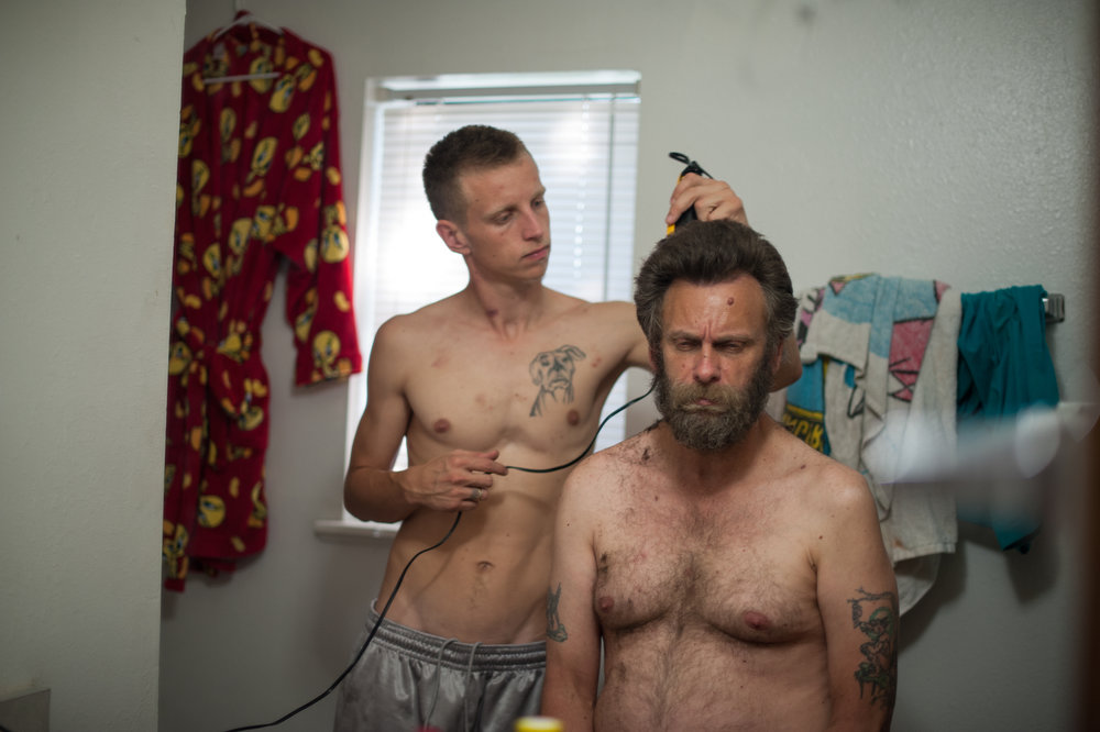 David, age 21, shaves his dad, Dave's, head before David's trial, 2014.