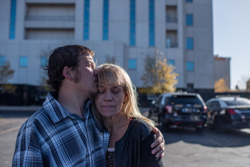 Vinny, age 18, holds his mom, Eve, and kisses her on the head after he is acquitted of punching his friend, who had hit his girlfriend's nephew, 2017.