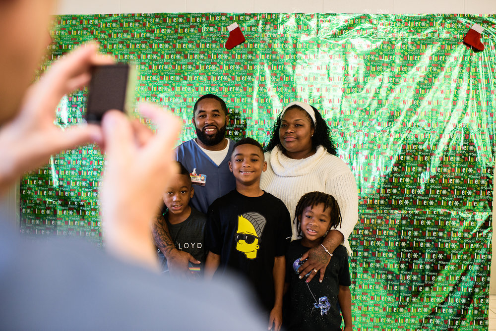 Rogelio and Sandrika stand with their sons, Rodarion, age 9, Rohandrick, age 6, and Romarion, age 4, for a Christmas picture at the Everglades Reentry Center in Miami, Florida.