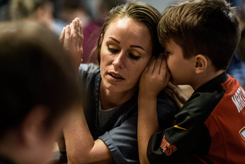 Caleb, age 7, whispers in his mom, Mary's, ear during a visit at the Hernando Correctional Institution in Ocala, Florida.