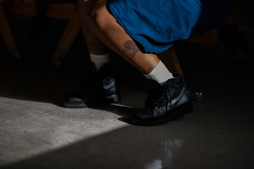 A woman's leg as she sits during a mother-child visit at Homestead Correctional Institution in Florida City, Florida.