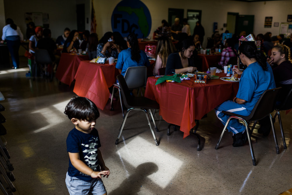 Jakey, age 2, paces beside tables of mothers and children at the Homestead Correctional Institution in Florida City, Florida.
