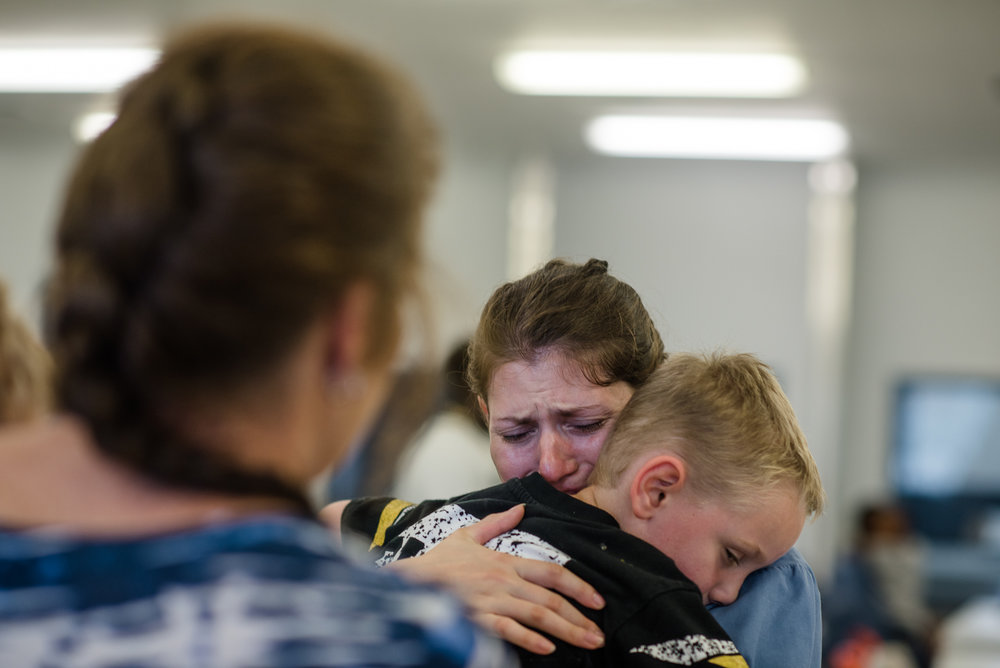 Jessie hugs her son goodbye as her mother stands with her during the end of a visit at the Lowell Correctional Institution in Ocala, Florida.