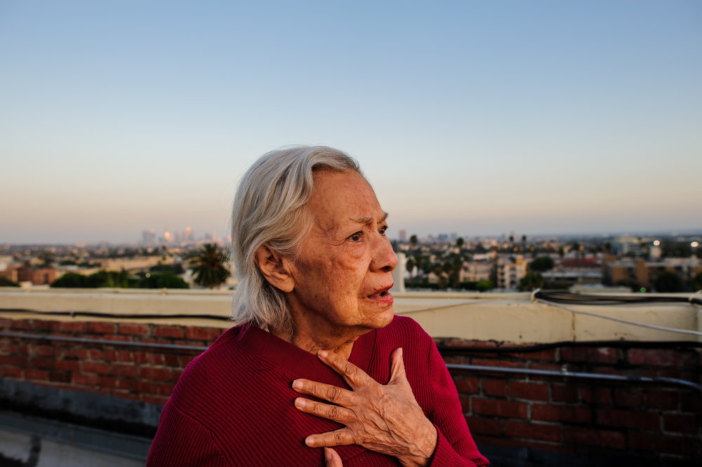 Bianca, age 85, stands on the roof of the retirement building where she lives in Los Angeles, 2010.