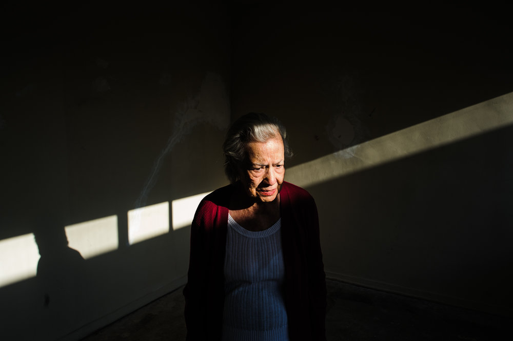 Bianca, age 85, stands in an empty apartment after deciding to switch apartments due to vertigo, 2010.