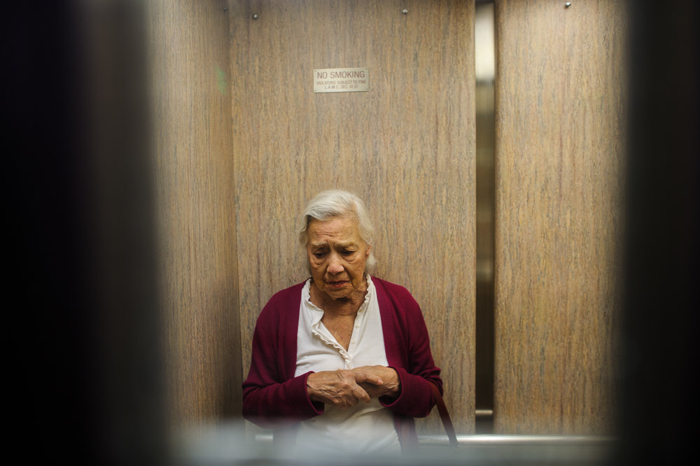 Bianca, age 85, stands in the elevator, 2010.