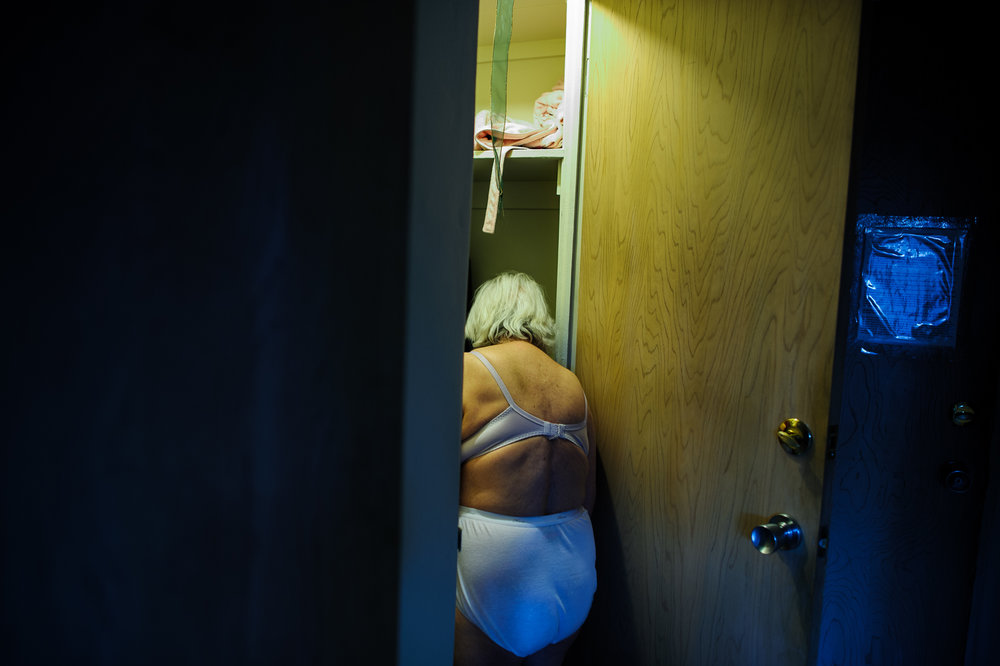 Bianca, age 85, looks for clothing in her closet, 2010.