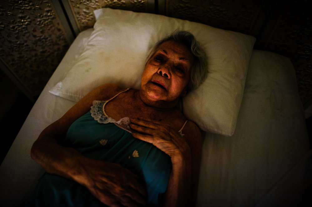 Bianca, age 87, lies on her bed, 2012.