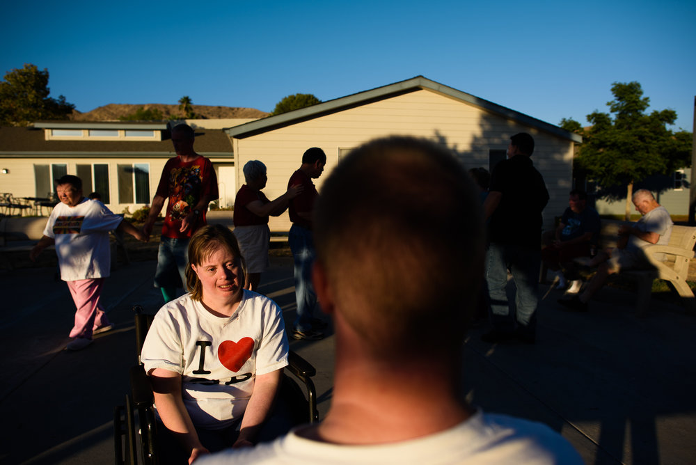 Krysta sits with Nathaniel during a dance party outside the homes at the ranch.