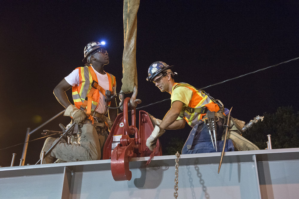 A team of construction workers repair a bridge in Sunnyside. Photo courtesy of MTA.
