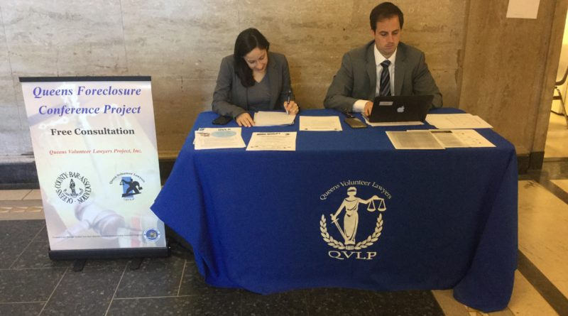 QVLP staff attorneys Kristen Dubowski and Justin Auslaender consult with homeowners facing foreclosure every Wednesday at 9:30 a.m. Photo Courtesy of QVLP.