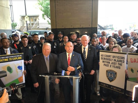Court officer union leaders Dennis Quirk (left at podium) and Patrick Cullen (right at podium) say court officer shortages will complicate implementation of the Raise the Age law set to take effect today. Advocates and court officials disagree. // Photo courtesy of Stuart Marques