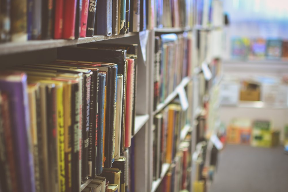 Books on the shelf of a library. Photo by Jamie Taylor on Unsplash.
