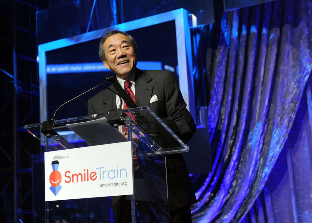 Charles B. Wang at the Barclay's Center in April 2014 to celebrate once million cleft surgeries by Smile Train. Photo by Diane Bondareff/Invision for Smile Train/AP Images).