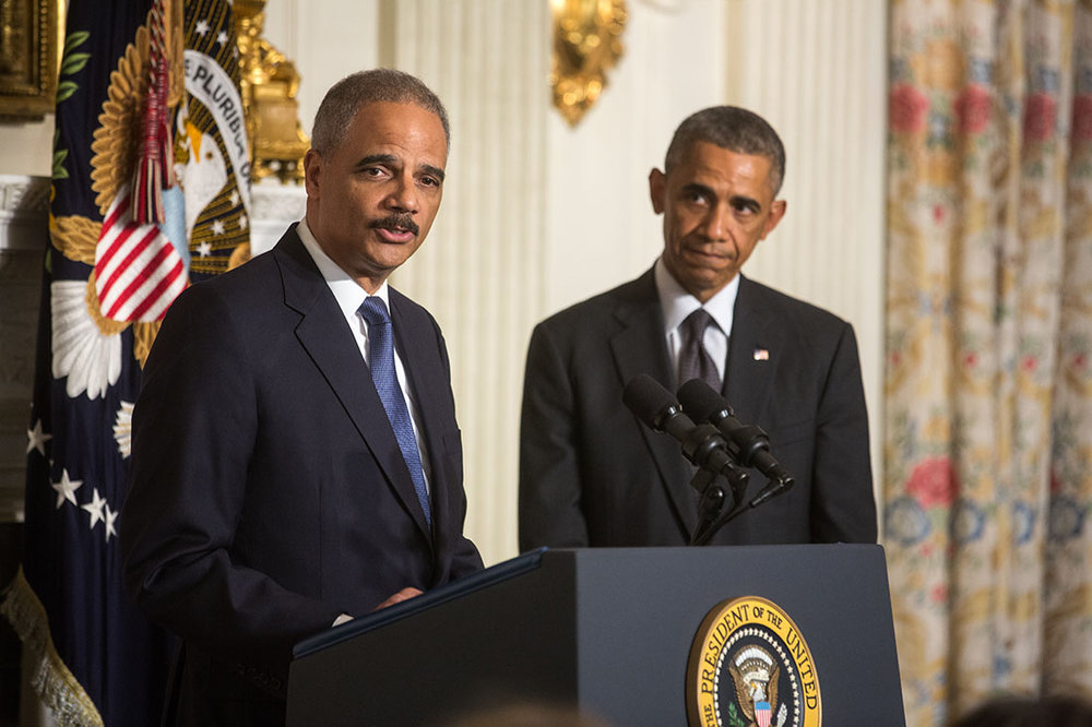Former Attorney General Eric Holder, an Elmhurst native, and former President Barack Obama (right) were among several prominent Democrats targeted with pipe bombs on Wednesday. // White House Photo by Chuck Kennedy