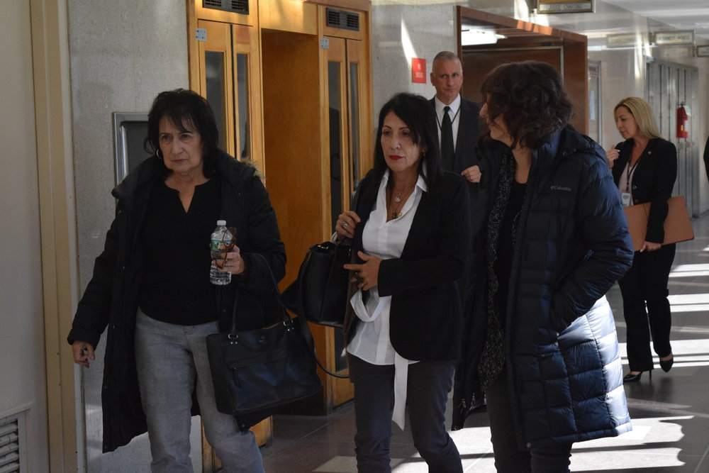 Karina Vetrano's mother Cathy (left) and Chanel Lewis' mother Veta leaves court after jury selection last Wednesday.  Eagle  photos by Christina Carrega.