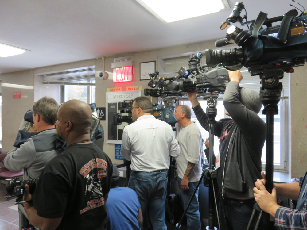 Members of the media staked out spots on the third floor of the Queens Criminal Courthouse Monday.  Eagle  photo.