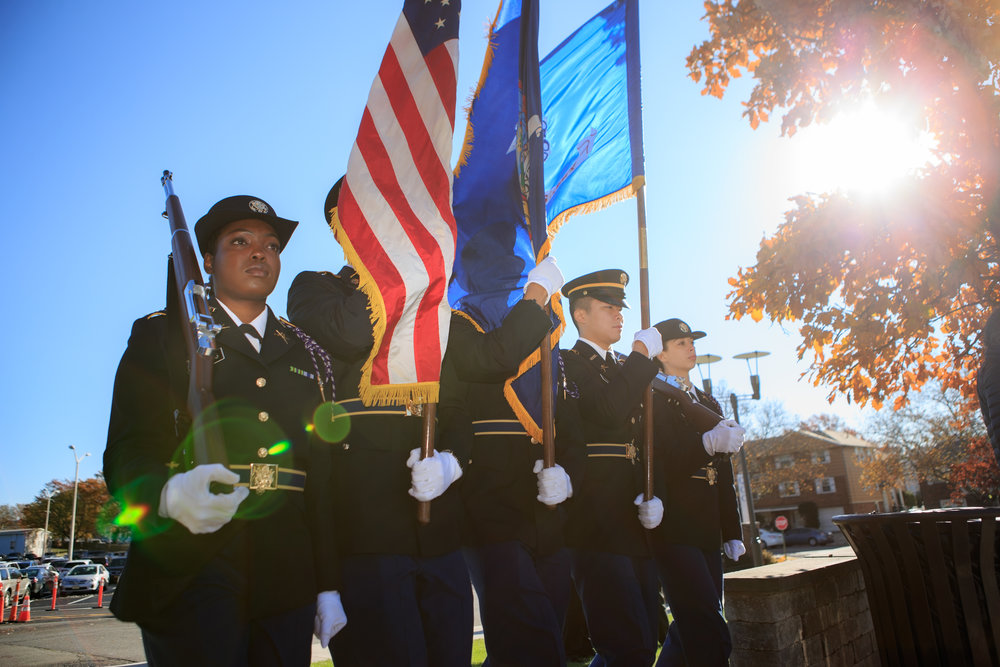 Members of the military carry flags at the Queensborough Community College Veterans Day commemoration last Wednesday. Photos courtesy of QCC.