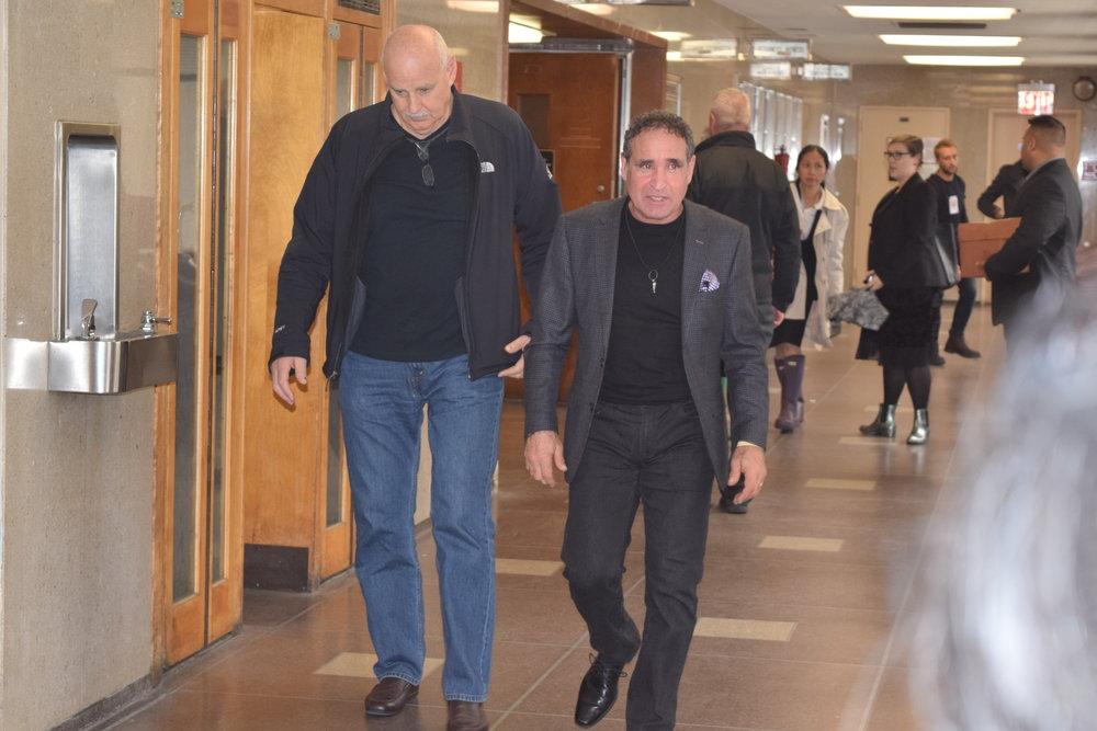 Karina Vetrano's father Phil Vetrano walks down the hall in Queens Criminal Court Tuesday. //  Eagle  photo by Christina Carrega