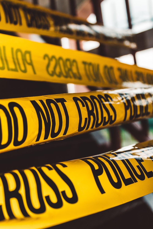 Crime scene police tape. Photo courtesy of Unsplash.