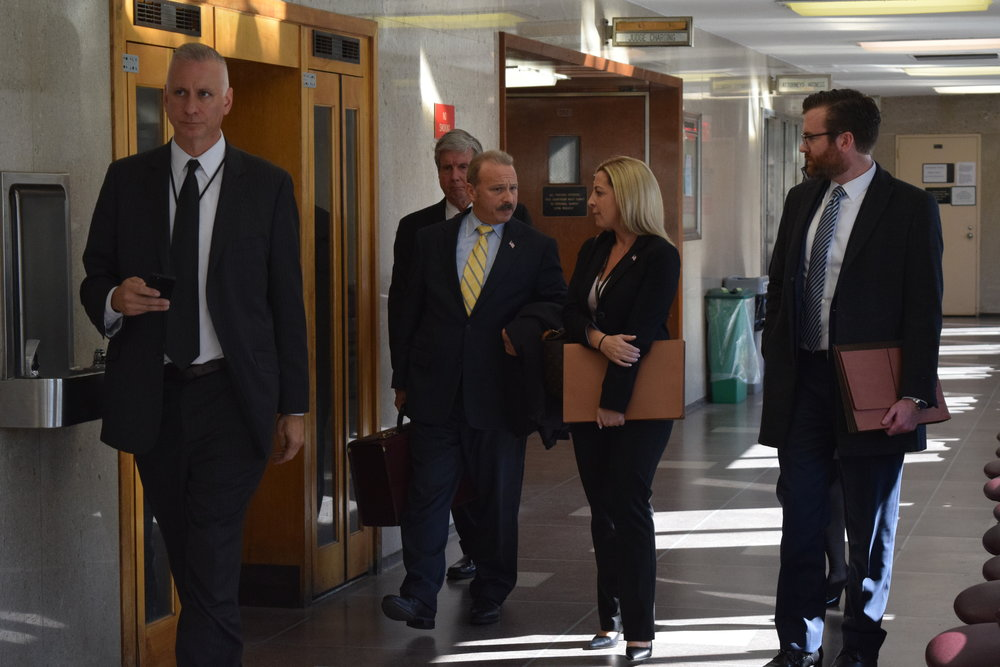 Assistant District Attorney Brad Leventhal (center, yellow tie) and Michael Curtis (far right). //  Eagle  photo by Christina Carrega