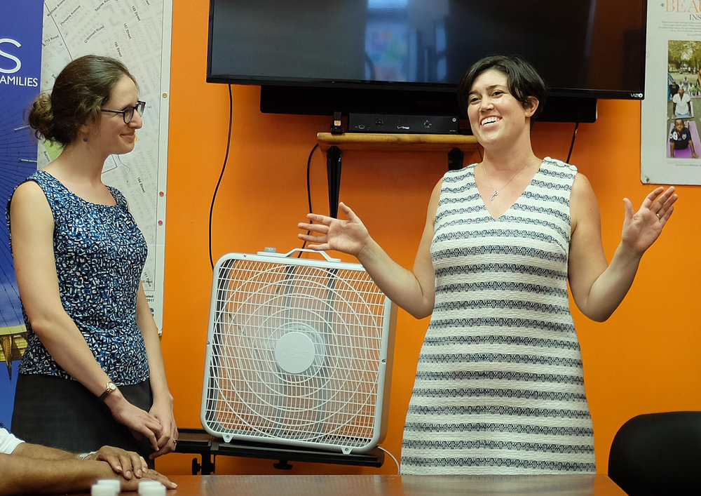 Legal Aid attorney Emma Goodman (right) has organized Case Closed workshops around Queens. In this August file photo, Goodman and Legal Aid attorney Melissa Ader discuss conviction-sealing at an event sponsored by Borough President Melinda Katz.  Eagle  file photo by Andy Katz.