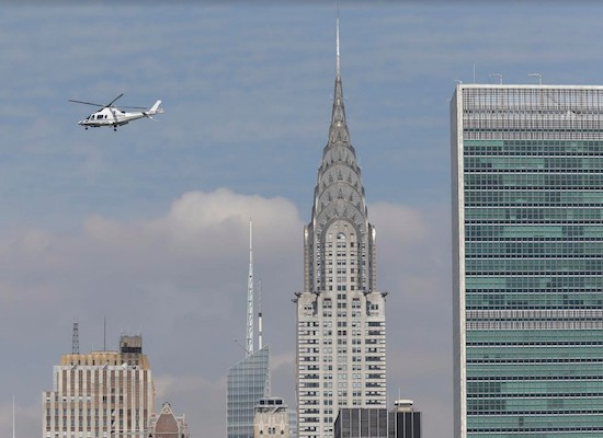 In this July 31 photo, a helicopter passes by the Chrysler Building in Manhattan. A Brooklyn man was arrested and charged on Monday after aiming a laser pointer at a helicopter near LaGuardia Airport. AP Photo/Seth Wenig.