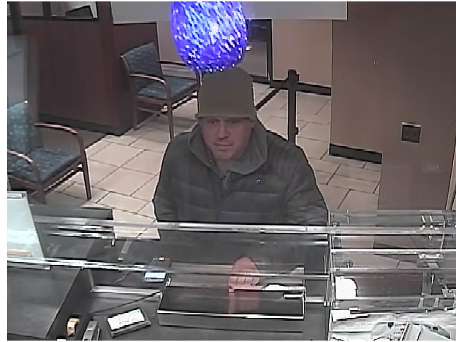 Still image of Victor Larson allegedly leaving a Chase Bank and Capital One Bank on Oct. 16. Photos courtesy of NYPD.