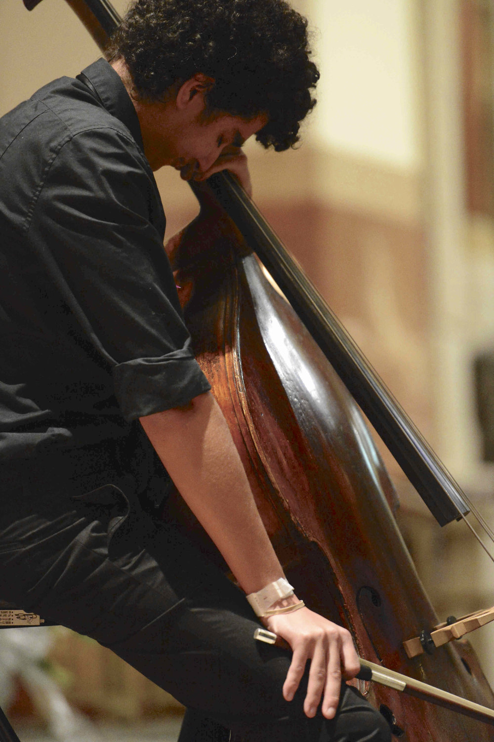 Matthew Peralta plays the cello at his father's funeral. //  Eagle  photo by Todd Maisel