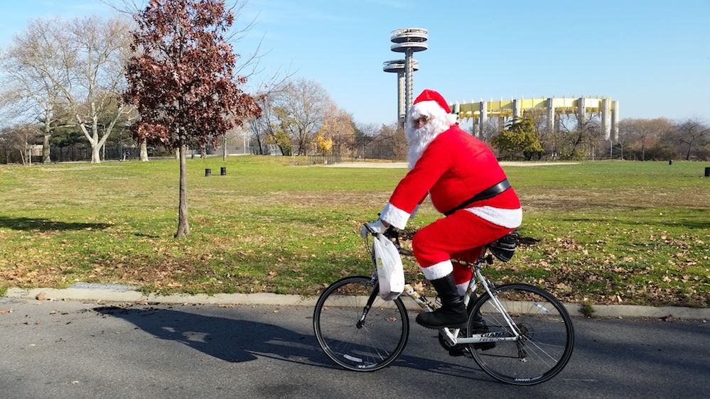 Santa rides his bike during the 2015 Santa Claus Bike Ride.