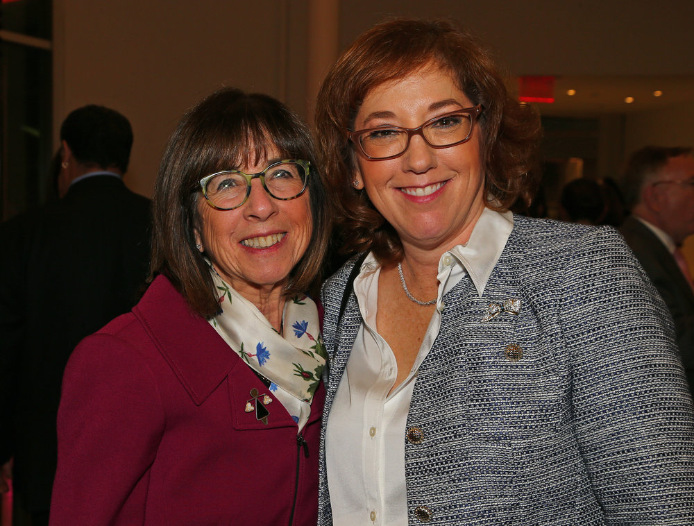 Judge Bernice Siegal (left) and Queens County Bar Association President Hillary Gingold.
