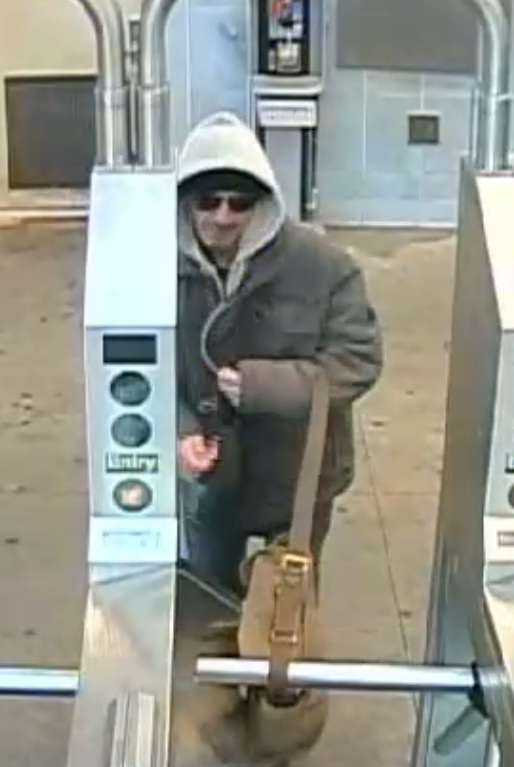Still image of a suspected burglar entering a Far Rockaway train station after using a stolen credit card to buy a MetroCard on Oct. 12, 2018. Photo courtesy of the NYPD.