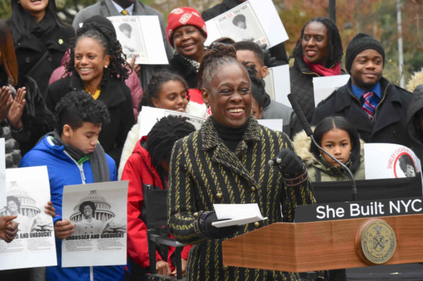 Chirlane McCray proudly announced statute site for Shirley Chisholm with many supporters.