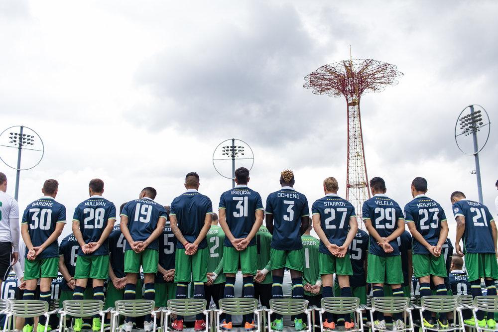 Players stand on the pitch at MCU Field in Coney Island. // Photo by Ben Nicholas