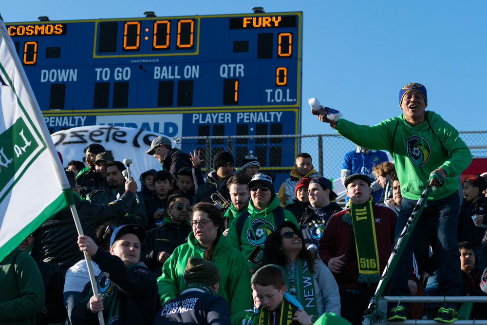 Cosmos support cheer on their club at their old home field at Hofstra University. // Photo by Steve Hamlin