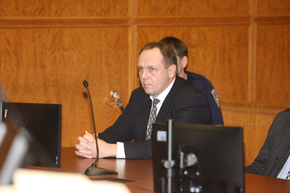 HVAC business owner Yuriy Kruk awaits a verdict by Justice Richard Buchter in Queens Criminal Court Monday. Pool photo by Ellis Kaplan.