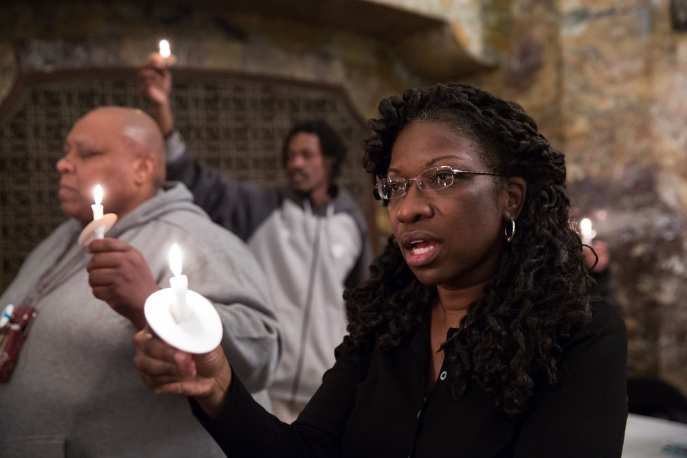 Attendees remember homeless New Yorkers who died in 2017 at last year's Homeless Persons' Memorial Day. Photo courtesy of Care for the Homeless