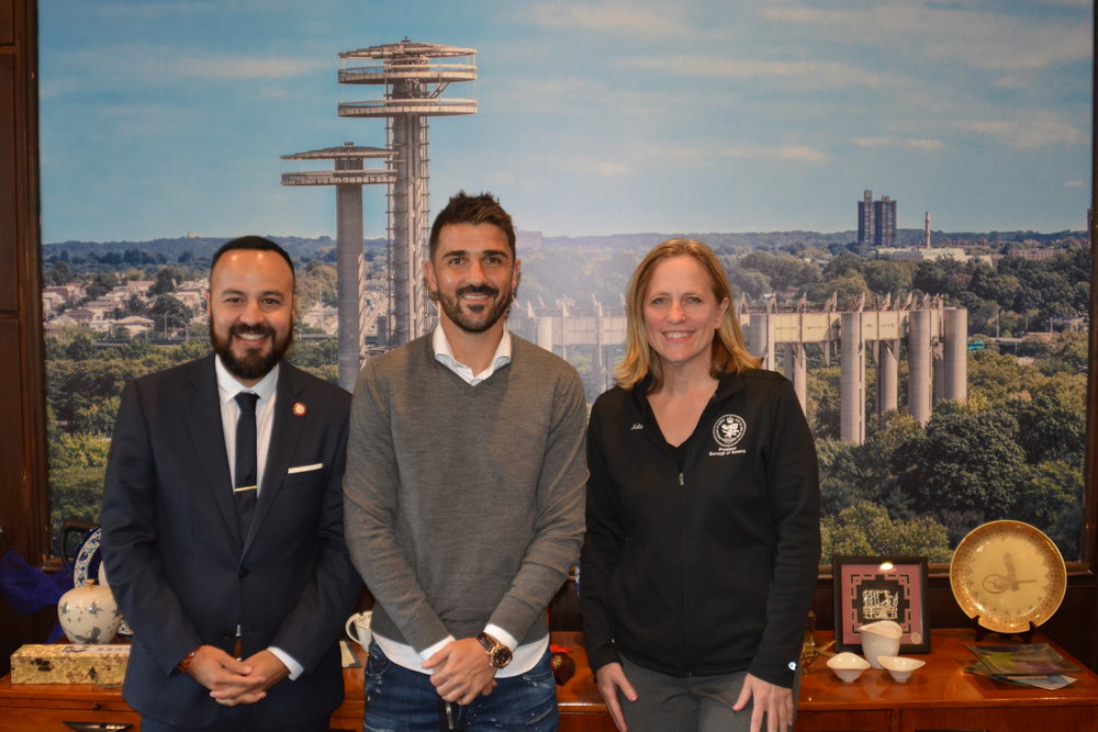"Soccer legend David Villa, who plays forward for NYCFC, met with Councilmember Francisco Moya and Queens Borough President Melinda Katz. According to the Borough President's office, the three discussed the future of soccer, including a ""proposal to build a 10,000- to 25,000-seat soccer stadium in the Willets Point redevelopment area that would serve as home for the Queensboro Football Club, a proposed new team that would play in the United Soccer League, a second division professional league."" Photo courtesy of Borough Hall"